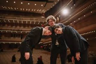 Zoltan Fejervari with the two runners up at the CMIM competition.  He is holding their two heads together.
