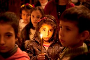 young-girl-holds-candle-damascus-syria