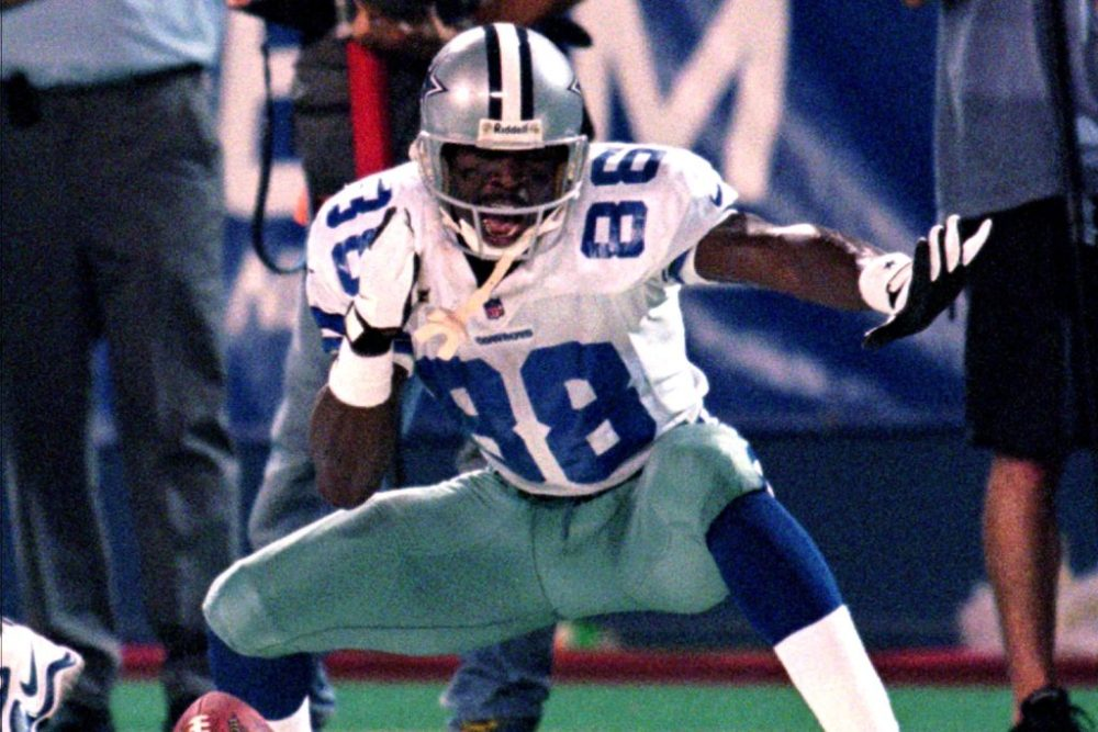 ** FILE ** Dallas Cowboys' Michael Irvin celebrates after gaining 30-yards on a Jason Garrett pass in the third quarter against the New York Giants in this Sept. 21, 1998 file photo, at Giants Stadium in East Rutherford, N.J. (AP Photo/Bill Kostroun, File)