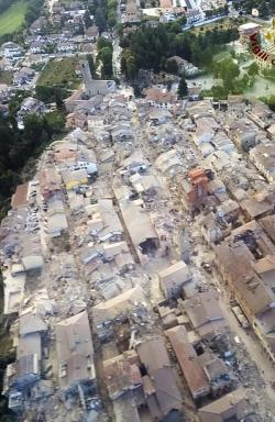 (This aerial view shows the damage in the town of Amatrice, central Italy. Picture: Italian Firefighters Vigili del Fuoco. Source: AP)