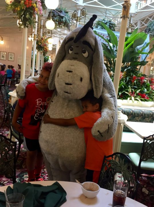 Eeyore at Crystal Palace being hugged by Theresa's two young nephews