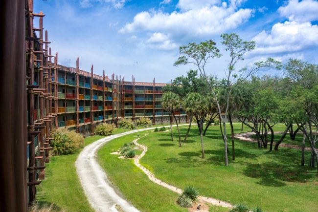 Bright blue skies and colorful balconies overlooking the green savanna at Disney's Animal Kingdom Lodge.