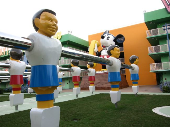 Giant foosball table and Mickey Mouse phone structures at Pop Century Resort