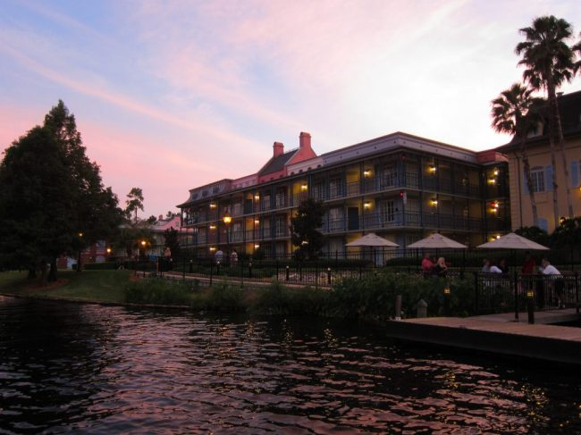 Sunset view of the waterfront area of Port Orleans French Quarter, one of the Best Walt Disney World Hotels