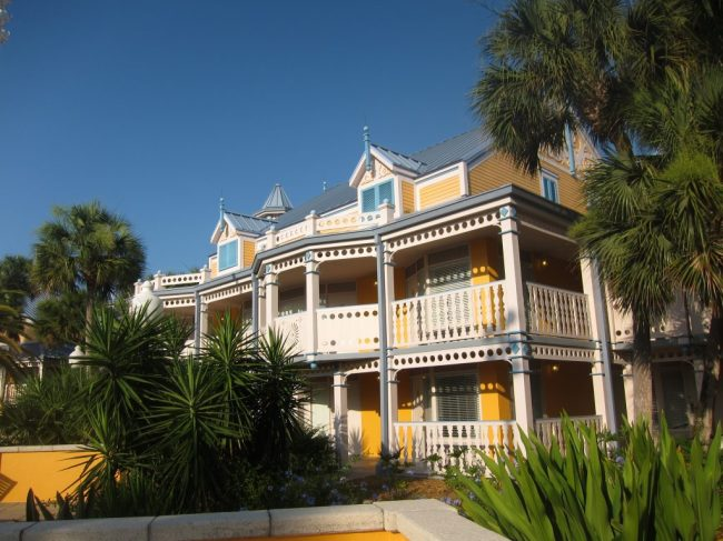 Green trees and yellow buildings help the Caribbean Beach Resort live up to its name.