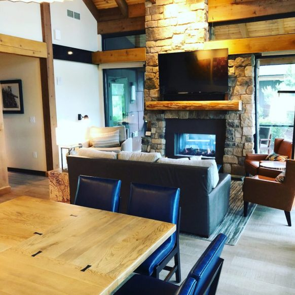 Wood tables, flooring and other accents play on the wilderness theming at the Copper Creek Cabins.