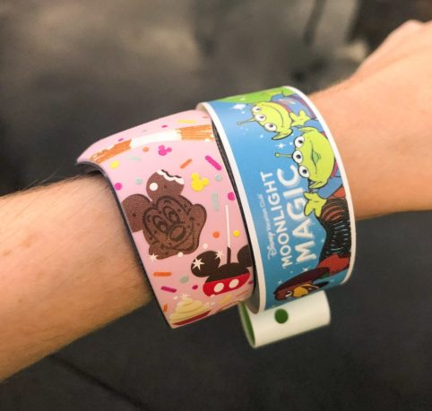 Theresa wearing her pink Disney-snack themed Magic band with her blue DVC Moonlight Magic wristband