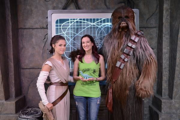 Theresa standing in the middle of Rey and Chewbacca from Star Wars during DVC Moonlight Magic