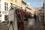 Small boutiques and shops shape the picture of Arhus' old town, where preserving tradition remains to be the main focus. The signs in front of these shops attract visitors and give them a hint of what they can find inside.