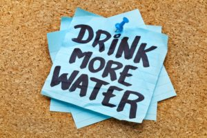Drink at least eight to 10 eight-ounce glasses of water a day.