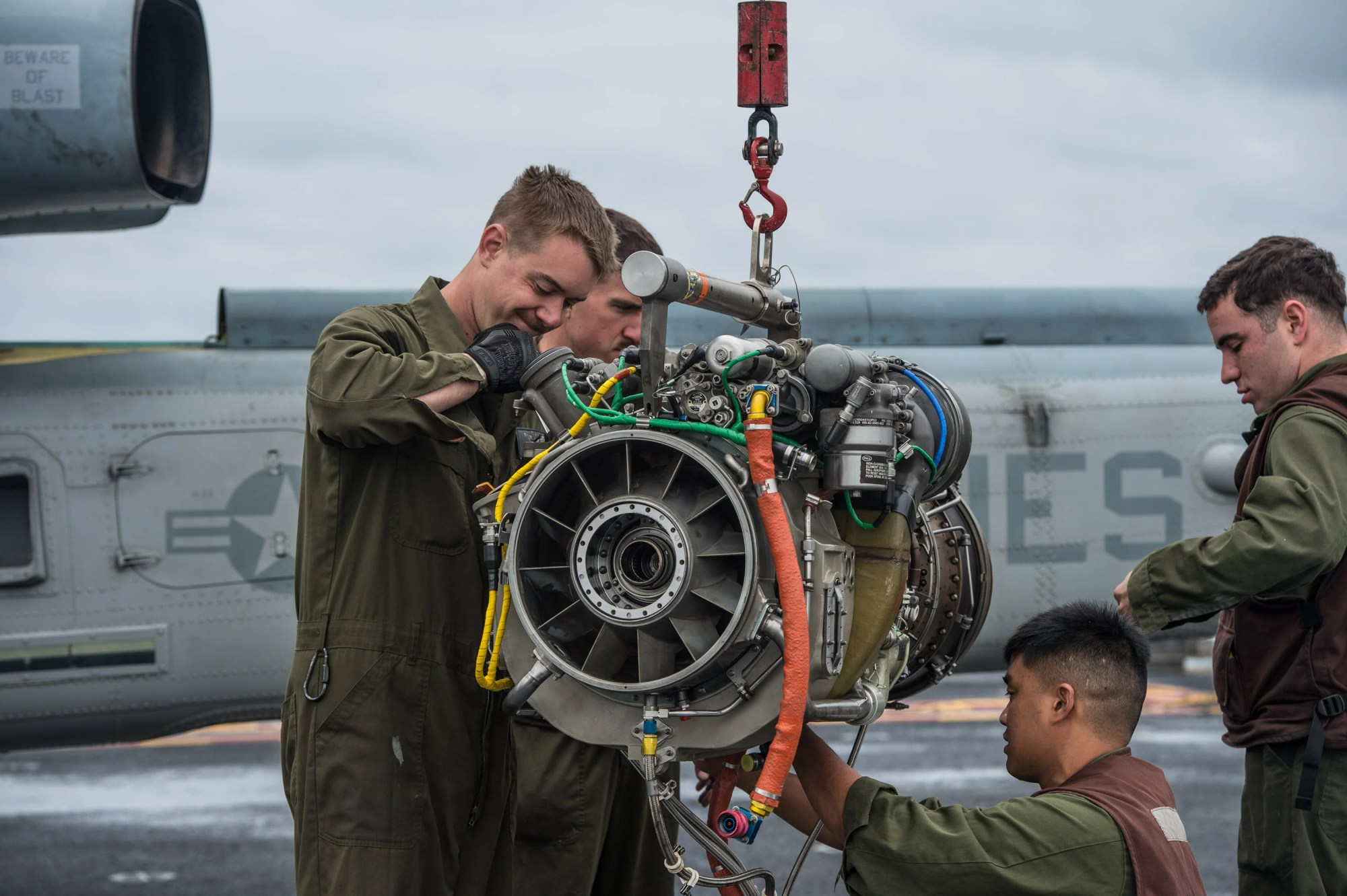 hight resolution of marines perform maintenance on a t700 ge 401c engine from a bell uh