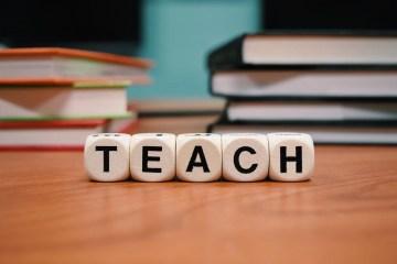 Teach written with blocks on a desk