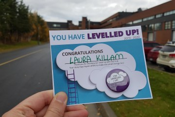 You have levelled up award with Cambrian in the background.