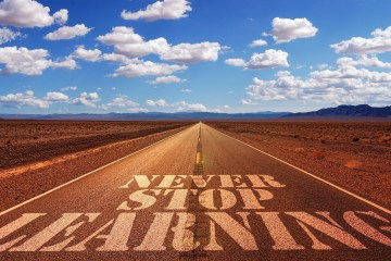 Never stop learning written on a road