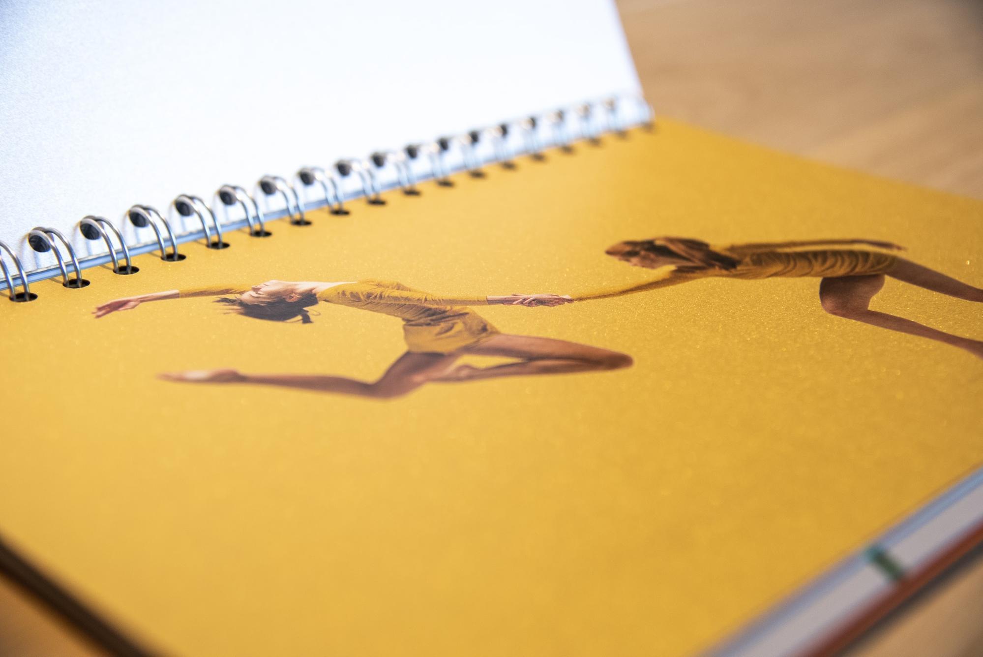 metallic ink example of two gymnasts on yellow background