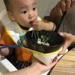 asian child eating nodles