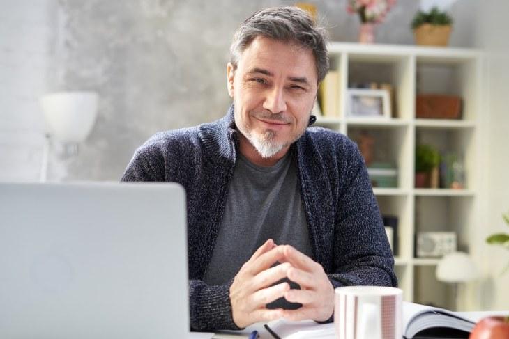 Smiling Man At His Desk