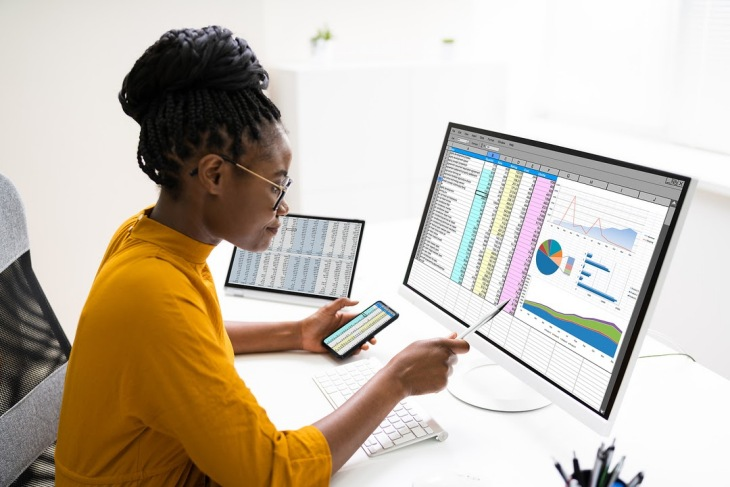 Woman Studying Charts And Graphs