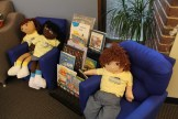 Books and friendly dolls invite little guests to explore and touch