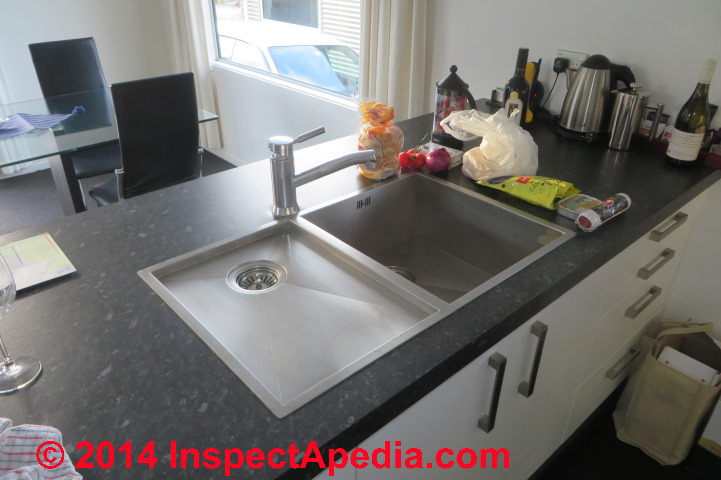 kitchen sink air gap cabinet installers island drain piping & venting