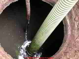 PHOTO of an septic tank during tank pumping.