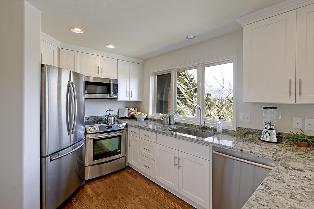 white cabinets with granite