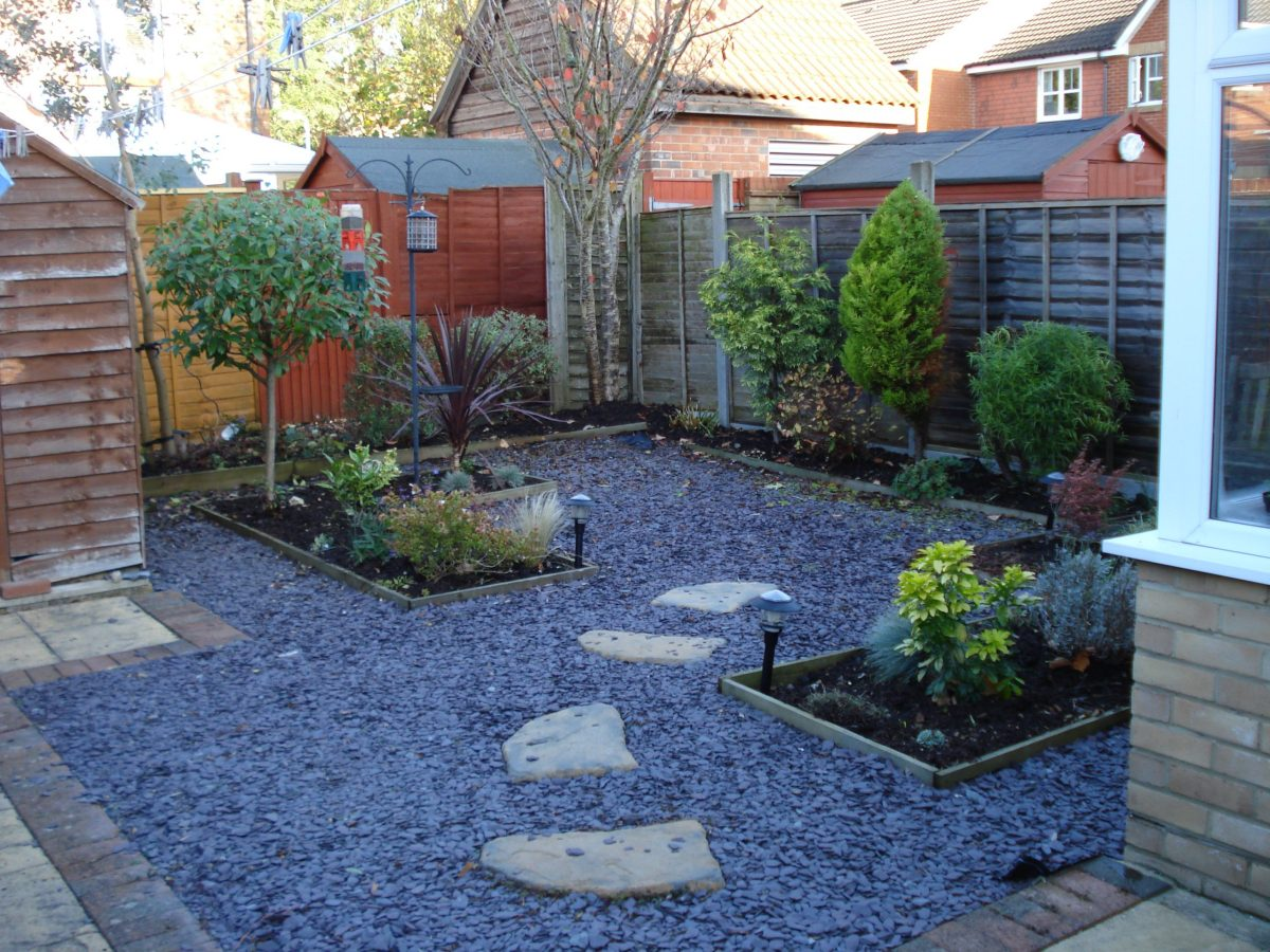 gravel and stone yard ideas no grass with planters