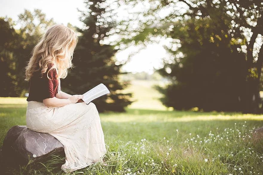 people girl alone sitting rock reading book bible nature