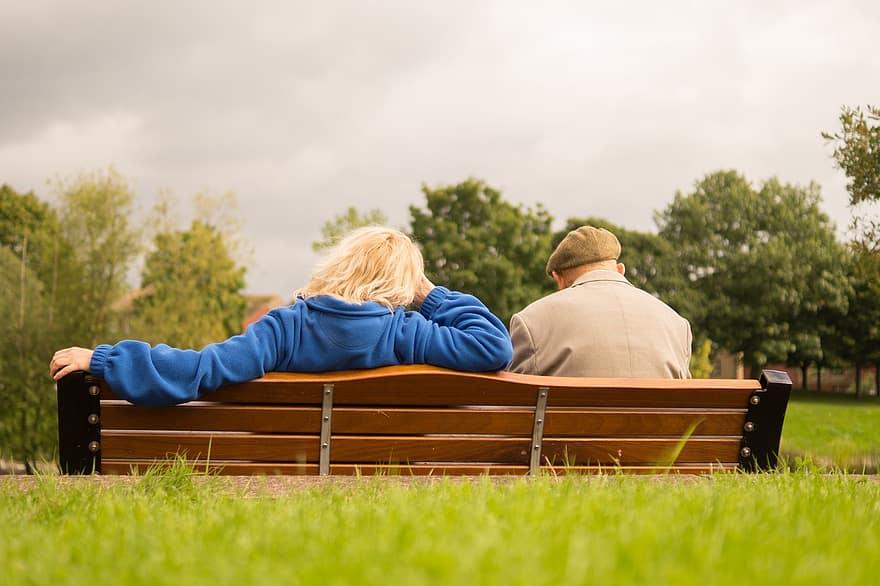 people sitting resting waiting man woman elderly person senior