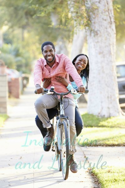Happy couple riding bicycle