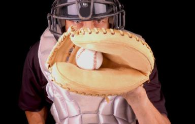 Baseball Catcher catching pitch