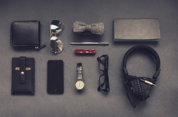 Knolling Photography of Smartphone watch, glasses, wallet, keys and other daily essentials