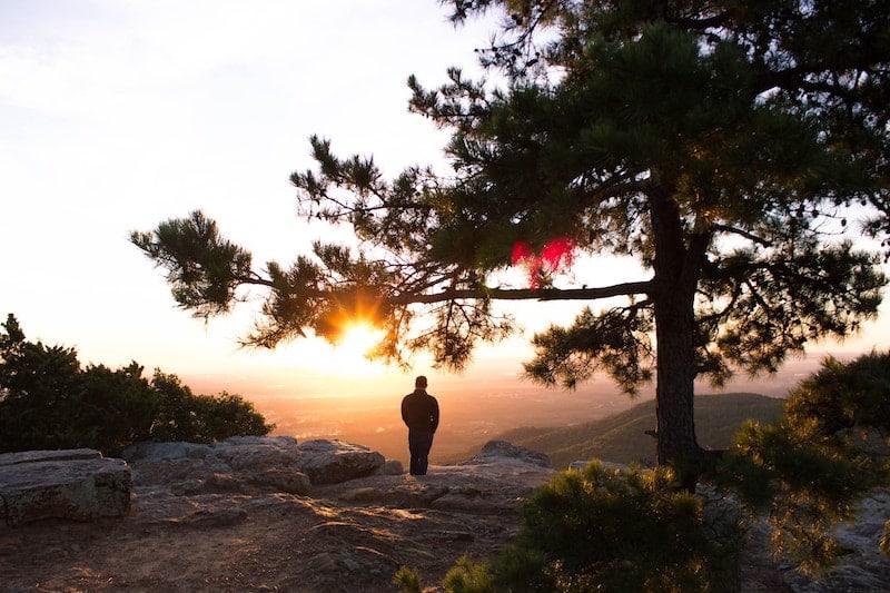 Young man watching sunrise