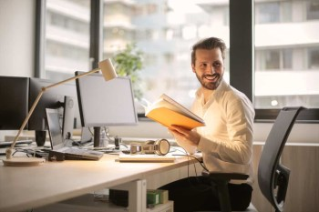 Young Man Working inside his office