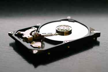 Old Hard Drive Disk against a dark table