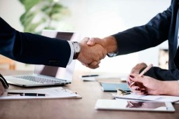 Two Person in Formal Attire Doing Shakehands