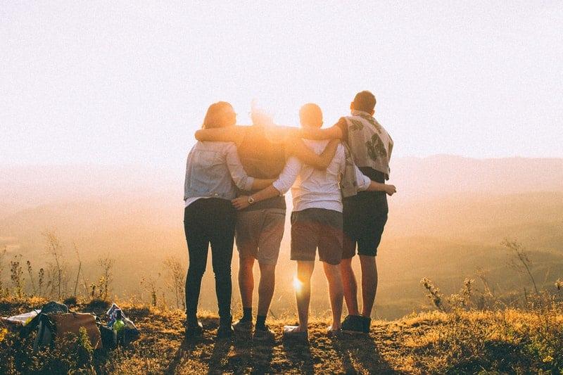 backlit friendship during sunset