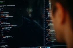 Man sitting at his workspace coding a new software