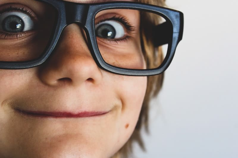 Surprised person wearing reading glasses