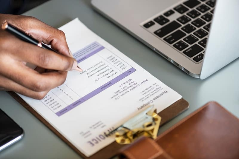 Man writing an Invoice for a Client