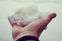 Man Holding a small cloud in his hand