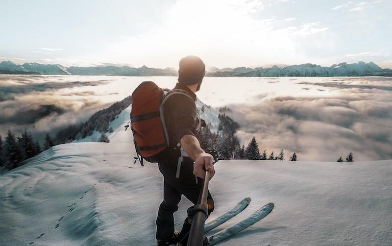 Man Using gopro to film himself Skiing
