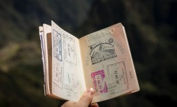 Passport open with different country stamps inside