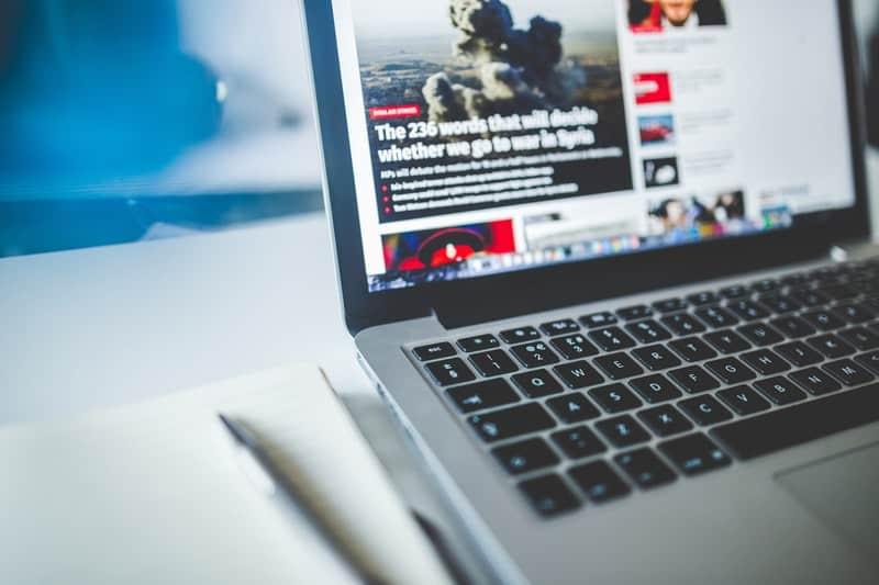 news website open on a macbook pro