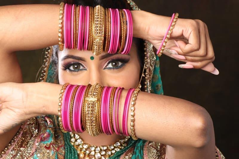 woman wearing plastic bangle bracelets