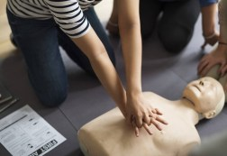 person-performing-cpr-on-dummy