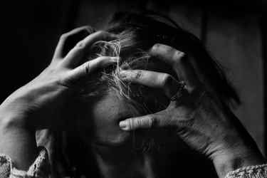 stressed out woman pulling her hair