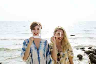 Two women using frames for a creative photo