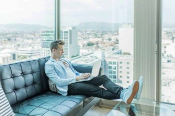 entrepreneur working in an office building overlooking the city