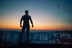 Man Overlooking a Cityscape during dusk